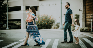 family crossing the street in crosswalk; blog: Why Do We Need Family Planning?