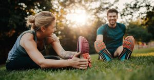 Fitness couple stretching outdoors in park. Young man and woman exercising together in morning; blog: how are lifestyle and fertility linked?